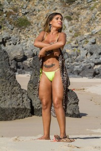 **WARNING: NUDITY** Miss Butt Brazil model Andressa Urach goes topless on secluded beach
